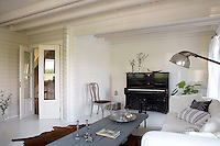 The colour scheme throughout the house is grey-and-white seen here in the cool and elegant living room