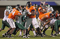 Oct 23, 2010; Charlottesville, VA, USA; Virginia Cavaliers wide receiver E.J. Scott (84), Virginia Cavaliers offensive tackle Morgan Moses (78) and Virginia Cavaliers center Anthony Mihota (68) block Eastern Michigan Eagles defensive tackle Javon Reese (90) and Eastern Michigan Eagles linebacker Marcus English (42) during the game at Scott Stadium.  Virginia won 48-21. Mandatory Credit: Andrew Shurtleff