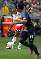 CHESTER, PA - OCTOBER 27, 2012:  Amobi Okugo (14) of the Philadelphia Union watches a pass from  Thierry Henry (14) of the New York Red Bulls during an MLS match at PPL Park in Chester, PA. on October 27. Red Bulls won 3-0.