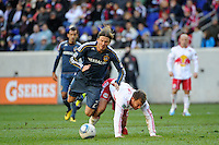 David Beckham (23) of the Los Angeles Galaxy is fouled by Teemu Tainio (2) of the New York Red Bulls during the 1st leg of the Major League Soccer (MLS) Western Conference Semifinals at Red Bull Arena in Harrison, NJ, on October 30, 2011.