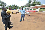 Jacques Umembudi Akasa, a United Methodist missionary pilot for Wings of Caring Aviation, a program of the United Methodist Church in the Democratic Republic of the Congo, is welcomed to the village of Minga.