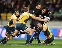 Ma'a Nonu prepares to fend David Pocock during the Investec Tri-Nations match between All Blacks and Australia at Westpac Stadium, Wellington, New Zealand on Saturday 19 September 2009. Photo: Dave Lintott / lintottphoto.co.nz