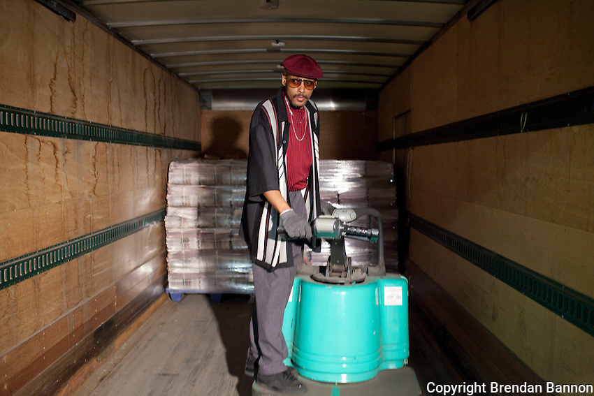Journeyman Anthony Meeks  loads a truck for a delivery run. The truck will carry roughly 34,000 copies of the newspapers 177,600 paper's Friday print run. The paper has been owned by Warren Buffett since 1977. Buffett announced the purchase of an additional 63 newspapers in May of 2012. Photo: Brendan Bannon, Buffalo, NY, June 8, 2012.