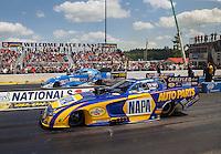 Jun 6, 2016; Epping , NH, USA; NHRA funny car driver Ron Capps (near) races alongside John Force during the New England Nationals at New England Dragway. Mandatory Credit: Mark J. Rebilas-USA TODAY Sports