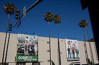 """Burbank, California, July 14, 2010 - A view of new television posters for Gossip Girl and The Big Bang Theory at Warner Brothers studio. Bob McCullough, who was one of the 165 television writers who were plaintiffs in a long-running age-bias case against more than two-dozen defendants that essentially run the television business, says that his career was essentially over when he turned 55. """"It became apparent that the Aloha shirts and young persona were not fooling the young executives that I was meeting with,"""" he says. """"They said, 'Gosh, you wrote my mother's favorite TV show!' My agent said, 'There's not much more we can do for you. Your time is done.' He was absolutely ruthless and brutal.""""."""