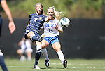 09 September 2012: Marquete's Cara Jacobson (9) and Duke's Erin Koballa (14). The Duke University Blue Devils defeated the Marquette University Golden Eagles 5-2 at Koskinen Stadium in Durham, North Carolina in a 2012 NCAA Division I Women's Soccer game.