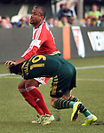 Jun 6, 2015; Portland, OR, USA; New England Revolution forward Teal Bunbury (10) gets tangled up with Portland Timbers defender Jorge Villafana (19) during the first half of the game at Providence Park. Both players received yellow cards for the play. Mandatory Credit: Steve Dykes-USA TODAY Sports