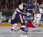 "3/11/05 Omaha Neb. Lake Superior State's Trent Campbell checks University of  Nebraska at Omaha""s Mike Eickman  during the third period of Friday nights game at the Qwest Center Omaha. University of  Nebraska at Omaha won the first game of the CCHA play-offs.(chris machian/Prarie Pixel Group)"