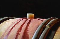 Red wine in an oak barrel at Lucien Muzard in Santenay, Bourgogne