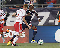 New England Revolution forward Dimitry Imbongo (92) on the attack. In a Major League Soccer (MLS) match, the New England Revolution (blue) tied New York Red Bulls (white), 1-1, at Gillette Stadium on May 11, 2013.