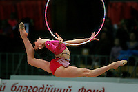 "Elizabeth Paisieva of Bulgaria split leaps for hoop re-catch at 2008 World Cup Kiev, ""Deriugina Cup"" in Kiev, Ukraine on March 22, 2008."