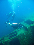 "Diving Bonaire, Netherland Antilles -- Divers explore the wreck of the Hilma Hooker.  (""Hilma Hooker"" dive site)."