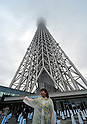 May 22, 2012, Tokyo, Japan - The Tokyo Skytree, the worlds tallest self-standing terrestrial broadcast tower at 634 meters, opens to the public in downtown Tokyo on Tuesday, May 22, 2012...Despite the foul weather, some 8,000 visitors turned out on the first day to see the limited but 360-degree views of the nations capital from two observation decks. On the opening day alone, the operator expected about 200,000 visitors to Tokyo Skytree Town commercial complex, which consists of the tower, a 312-tenant shopping and restaurant zone called &quot;Tokyo Solamachi,&quot; an office building zone, an aquarium and a planetarium. (Photo by Natsuki Sakai/AFLO) AYF -mis-.