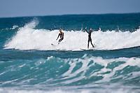 TAJ BURROW (AUS) getting the finger from a grommet while surfing at 13th Beach, Barwon Heads, Victoria, Australia  Photo: joliphotos.com