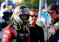 Sep 13, 2013; Charlotte, NC, USA; Billy Torrence (left) with son NHRA top fuel dragster driver Steve Torrence (center) and a crew member during qualifying for the Carolina Nationals at zMax Dragway. Mandatory Credit: Mark J. Rebilas-