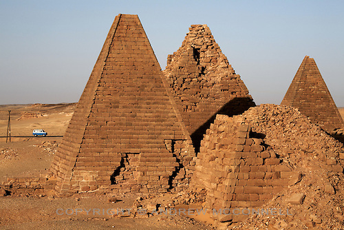 The pyramids at Jebel Barkal, Sudan, pictured on Tuesday, March 27, 2007. This small royal cemetery contains around 20 pyramids and was used by Napatan Kings during the 3rd century BC. They are some of the most complete pyramids in Sudan...The ancient kingdom of Kush emerged around 2000 BC in the land of Nubia, what is today northern Sudan. At their height the Nubians ruled over ancient Egypt as the 25th Dynasty between 720 BC and 664 BC (known as the Black Pharaohs) and saw their borders reach to edges of Libya and Palestine. The Kushite kings saw themselves as guardians of Egyptian religion and tradition. They centered there kindgom on the Temple of Amun at Napata (modern day Jebel Barkal) and brought back the building of Pyramids in which to inter their kings - there are around 220 pyramids in Sudan, twice the number in Egypt. After Napata was sacked, by a resurgent Egypt, the capital was moved to Meroe where a more indigenous culture developed, Egyptian hieroglyphics made way for a cursive Meroitic script, yet to be deciphered. The Meroitic kingdom eventually fell into decline in the 3rd century AD with the arrival of Christianity.
