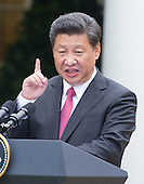 President XI Jinping of China conduct a makes remarks as he conducts a joint press conference with United States President Barack Obama in the Rose Garden of the White House in Washington, DC on Friday, September 25, 2015.<br /> Credit: Ron Sachs / CNP