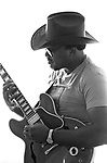 Otis Rush, Sept 1985, San Francisco Blues Festival. blues musician, singer and guitarist. His distinctive guitar style features a slow burning sound and long bent notes. With similar qualities to Magic Sam and Buddy Guy, his sound became known as West Side Chicago blues and became an influence on many musicians including Michael Bloomfield and Eric Clapton. Rush is left-handed and, unlike many left-handed guitarists, plays a left-handed instrument strung upside-down with the low E string at the bottom.