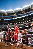 Massimo Ambrosini (23) of A. C. Milan and goalkeeper Iker Casillas (1) of Real Madrid lead their teams onto the field. Real Madrid defeated A. C. Milan 5-1 during a 2012 Herbalife World Football Challenge match at Yankee Stadium in New York, NY, on August 8, 2012.