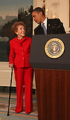 Washington, DC - June 2, 2009 -- United States President Barack Obama and former first lady Nancy Reagan at the signing of the Ronald Reagan Centennial Commission Act in the Diplomatic Reception Room of the White House on Tuesday, June 2, 2009..Credit: Dennis Brack / Pool via CNP