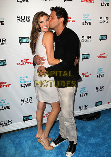 "Heather McDonald, Joe Francis.Bravo's Andy Cohen's Book Release Party For ""Most Talkative: Stories From The Front Lines Of Pop Held at SUR Lounge, West Hollywood, California, USA..May 14th, 2012.full length grey gray jeans denim black jacket dress side arm around waist hug embrace kiss kissing.CAP/ADM/KB.©Kevan Brooks/AdMedia/Capital Pictures."