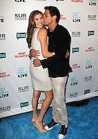 Heather McDonald, Joe Francis.Bravo's Andy Cohen's Book Release Party For &quot;Most Talkative: Stories From The Front Lines Of Pop Held at SUR Lounge, West Hollywood, California, USA..May 14th, 2012.full length grey gray jeans denim black jacket dress side arm around waist hug embrace kiss kissing.CAP/ADM/KB.&copy;Kevan Brooks/AdMedia/Capital Pictures.