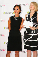 Josie Natori and Carole Hochman on stage at the CURVE and CFDA Party For A Cause event during the CURVENY Lingerie & Swim show, at the Jacob Javits Convention Center, August 2, 2010.