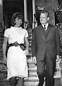 Former first lady Jacqueline Bouvier Kennedy, left, walks West Berlin Mayor Wily Brandt, right, to his waiting car in front of her Georgetown home in Washington, DC on May 19, 1964.  Mayor Brandt took time out from his schedule to pay a courtesy call on Mrs. Kennedy.<br /> Credit: Benjamin E. &quot;Gene&quot; Forte / CNP