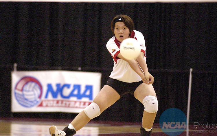 07 DEC 2002:  Yu Chuan Weng (24) of BYU- Hawaii hits a bump against Truman State University during the Division II Women's Volleyball Championship held at the WTAMU Event Center on the West Texas A&M University campus in Canyon, TX.  BYU-Hawaii defeated Truman State 3-0 for the national title.  Henry Bargas/NCAA Photos
