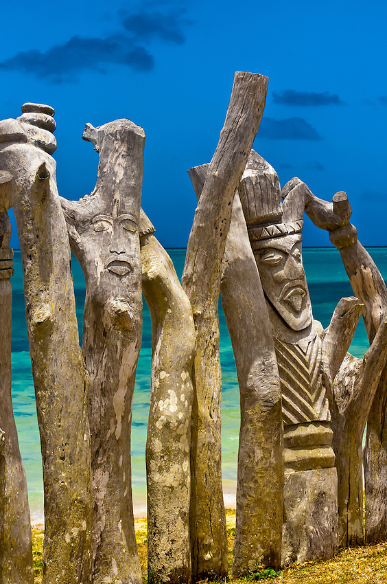 Carved posts (totem poles), St. Maurice Bay, near Vao, Ile des Pins ...