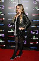 CARMEN ELECTRA .At SWAGG VIP Kid Rock Concert at the Joint inside the Hard Rock Hotel and Casino, Las Vegas, Nevada, USA,.7th January 2010..full length black leather jacket dress tights necklace platform shoes pearls beads hand on hip side heels .CAP/ADM/MJT.© MJT/AdMedia/Capital Pictures.