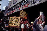 "Gay activists protest the military ""Don't Ask, Don't Tell"" policy on homosexuals in the armed forces in Times Square in New York in front of the military recruitment office in 1993. (© Frances M. Roberts)"