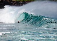 A body boarder gets barrelled on a big wave at Waimea Shorebreak in Waimea Bay on the North Shore of O'ahu