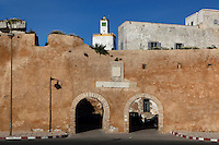 Doorways to the Portuguese Fortified city of Mazagan, 16th century, El Jadida, Morocco with the minaret of the Grand Mosque in the background. El Jadida, previously known as Mazagan (Portuguese: Mazag√£o), was seized in 1502 by the Portuguese, and they controlled this city until 1769.  Picture by Manuel Cohen