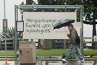 A man walks past a sign that reads, &quot;RELIGIONS ARE ALL ALIKE- FOUNDED UPON FABLES AND MYTHOLOGIES.  -- Thomas Jefferson, &quot; at Ocean Avenue on Tuesday, December 21, 2010. This sign is next to the Santa Monica Nativity Scenes at Palisades Park.