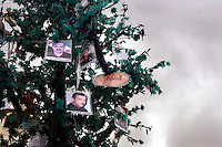 Pictures of those killed in the uprising hang on a tree in the newly renamed Liberty square in Zabadani, the only town in Syria officially held by the rebels of the Free Syrian Army. The hill town is surrounded by government forces. Protests against the ruling Baathist regime of Bashar al-Assad erupted in March 2011. Although they were initially peaceful,  they were violently repressed by the Syrian army and police. In response to being ordered to shoot unarmed civilians, large numbers of men deserted the army and formed the Free Syrian Army. The protest movement has now turned into an armed uprising with clashes between the regular army and the Free Syrian Army taking place in early 2012..