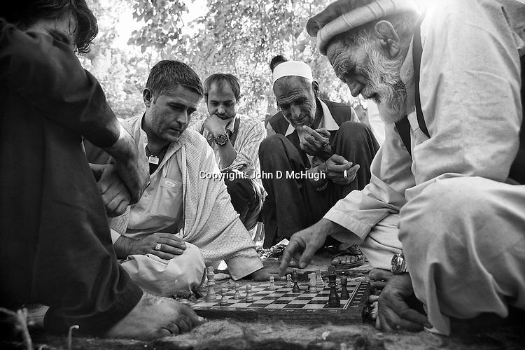 Afghan men play chess in Shar-I Now park, 31 August 2012. (John D McHugh)