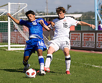 Andrew Oliver (16) of the United States fights for the ball with Kevin Barahona (16) of El Salvador during the quarterfinals of the CONCACAF Men's Under 17 Championship at Catherine Hall Stadium in Montego Bay, Jamaica. The USA defeated El Salvador, 3-2, in overtime.