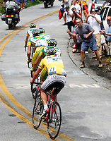 Phonak Hearing Systems riders pull race leader Floyd Landis (in yellow jersey) up a switchback on Wolf Pen Gap during Stage 4 of the Ford Tour de Georgia. Fred Rodriguez of Davitamon-Lotto won the 118.9-mile (191.4-km) stage from Dalton to Dahlonega.<br />