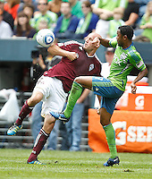 Colorado Rapids forward Conor Casey, left, and Seattle Sounders FC defender James Riley battle for the ball during play at CenturyLink Field in Seattle Saturday July 16, 2011. The Sounders won the game 4-3.