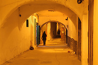 A narrow street with overhead archways in the medina or old town of Tetouan, on the slopes of Jbel Dersa in the Rif Mountains of Northern Morocco. Tetouan was of particular importance in the Islamic period from the 8th century, when it served as the main point of contact between Morocco and Andalusia. After the Reconquest, the town was rebuilt by Andalusian refugees who had been expelled by the Spanish. The medina of Tetouan dates to the 16th century and was declared a UNESCO World Heritage Site in 1997. Picture by Manuel Cohen