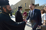Peter Prove (right), the director of international affairs of the World Council of Churches, greets Iraqi religious leaders as he arrives for a conversation at a church in Baghdad on January 21, 2017.