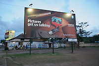 An billboard advertising MMS picture messaging on the Nokia 6700, on the edge of a small football field. Nokia market share 67.42% in Africa (May 2010) . http://stats.getjar.com/statistics/AF/manufacturer/Nokia