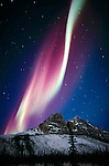 The aurora borealis is an atmospheric phenomenon that occurs as electrically charged particles from the sun make gases glow in the upper atmosphere. The Brooks Range in Alaska lies within the Arctic Circle and thus provides a more predictable chance to see the aurora borealis.
