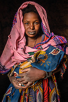 A portrait of a woman holding her baby in thw town of Gao. /Felix Features