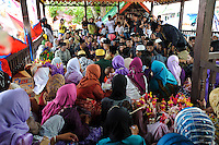 Religous ceremony at the Maulid Nabi festival, Cikoang, Sulawesi, Indonesia.