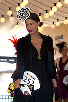 2008 Melbourne Cup Fashions on the Field winner Kirsty McGillvray on the catwalk