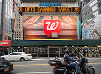The Walgreens drug store at One Times Square in New York is seen on Thursday, July 9, 2015. Walgreens Boots Alliance announced their third quarter profits beat analysts' expectations. The company is also closing 200 stores and using other cost-cutting measures to increase profitability.  (© Richard B. Levine)