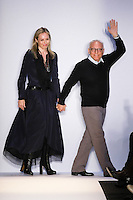 Fashion designer Max Azria (r) and wife Lubov, walk out at the close of the BCBGMAXAZRIA Fall 2011 fashion show, during Mercedes Benz Fashion Week.