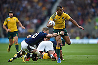 Kurtley Beale of Australia is tackled by Finn Russell of Scotland. Rugby World Cup Quarter Final between Australia and Scotland on October 18, 2015 at Twickenham Stadium in London, England. Photo by: Patrick Khachfe / Onside Images